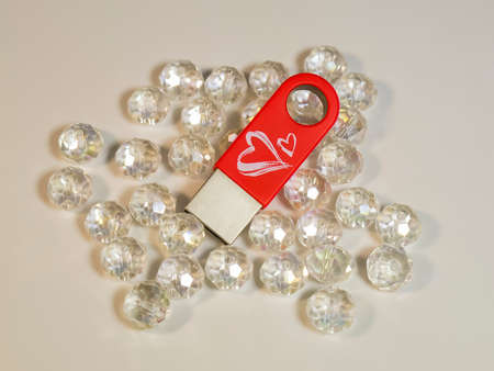 Red USB flash drive with heart and gems Stock Photo