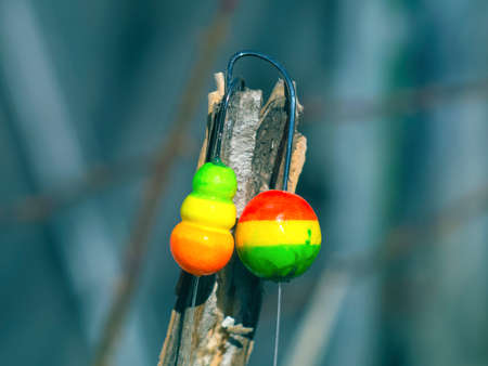 sinkers: two colorful float with a hook for fishing
