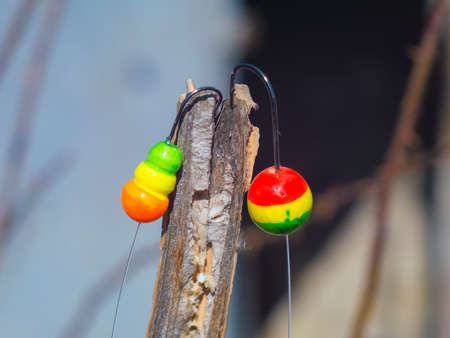 two colorful float with a hook for fishing closeup