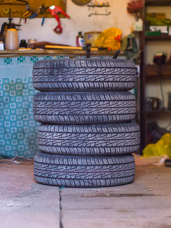 dirty car: The four car tires in the garage Stock Photo
