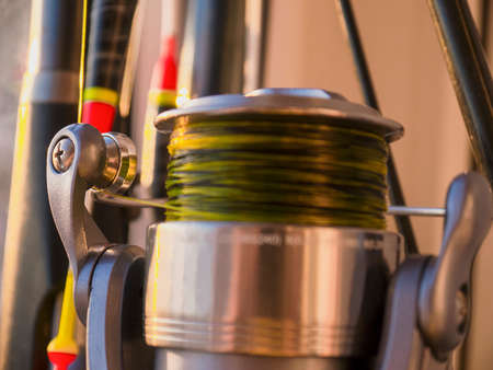 The fishing rod, float and fishing reel close-up