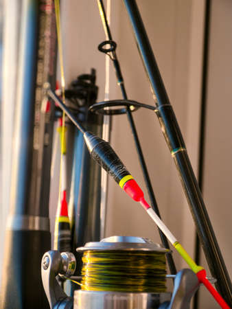 The float, fishing rod and fishing reel close-up Stock Photo