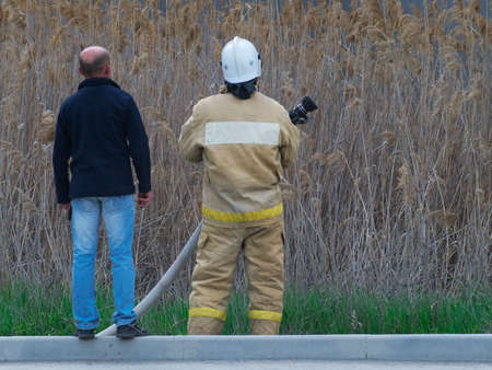 fireman: The fireman and the man are looking somewhere Stock Photo