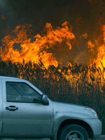 The car quickly rides around a huge fire