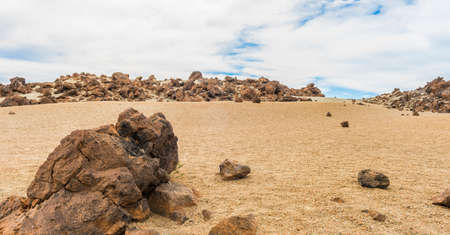 volcano slope: Rocks and sand and sky