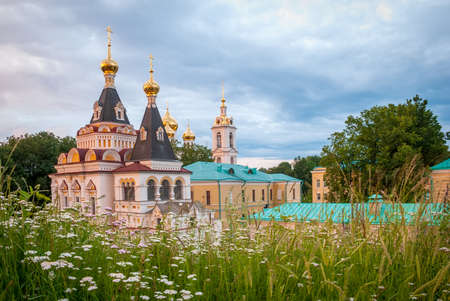 The Dmitrovsky Kremlin ensemble is a partially preserved fortress of the late XII century. Assumption Cathedral removed from the dugout against the background of the evening sky.