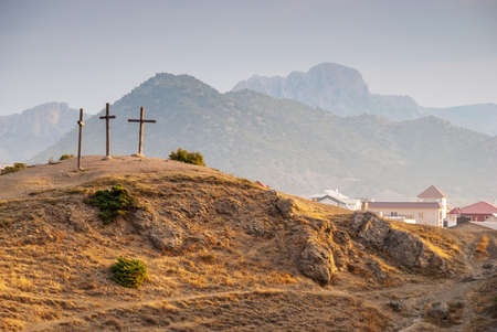 Morning mountain landscape. Sudak Calvary is a mountain with crosses. The city of Sudak. Crimea.