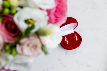 Wedding rings in a red velvet jewelry box