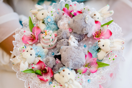 Multicolored bouquet with pink flowers and soft toys