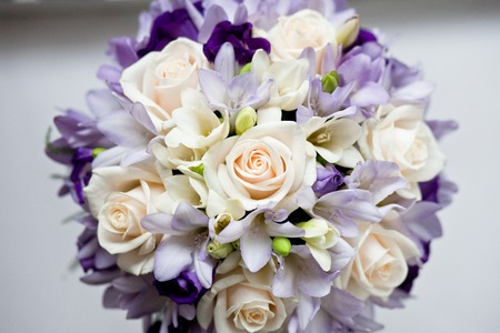 Wedding bouquet of roses and freesias in white and gray flowers