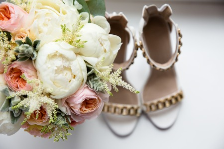 Wedding bouquet on the blurred background of the brides shoe