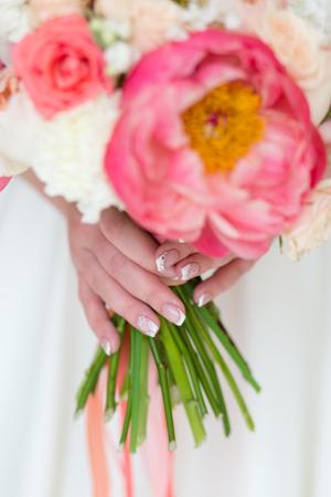 Wedding bouquet in the hands of the bride 版權商用圖片