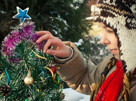 Girl decorating Christmas tree Stock Photo - 8528367
