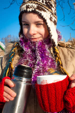 Girl holding a cup with hot drink Stock Photo - 8528369