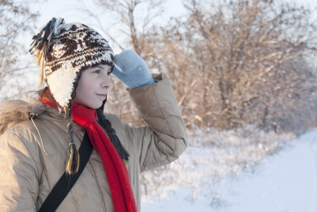 Teen girl looking far away at snowy winter day photo