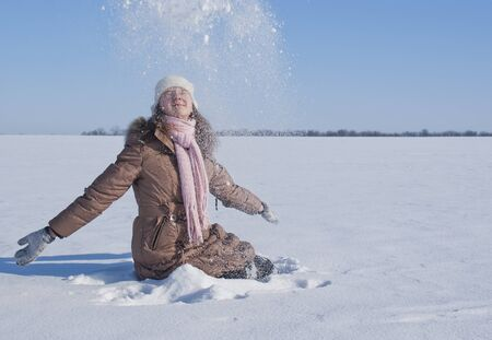 Teen girl playing with snow photo