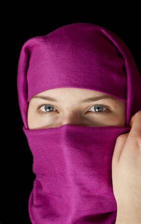 Caucasian girl muffled in a shawl photo