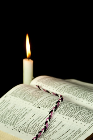 candle: Open Bible with burning candle