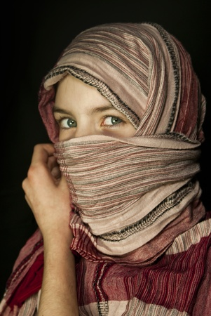 middle eastern clothing: Little girl muffled in a shawl Stock Photo