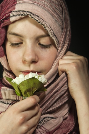 Little girl muffled in a shawl with flowers photo