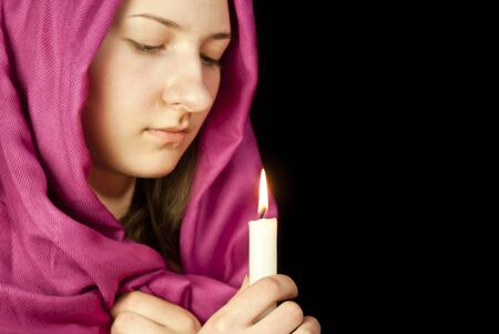 Eastern style dressed teen girl with a candle photo