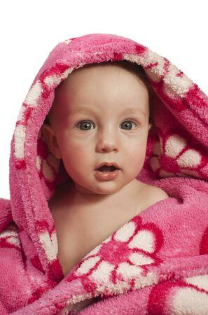 Little baby boy dressed in a rosy bathrobe
