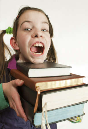 Surprised teen girl with a stack of books Stock Photo - 9156557