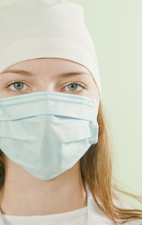 surgical cap: Young lady doctor wearing the mask