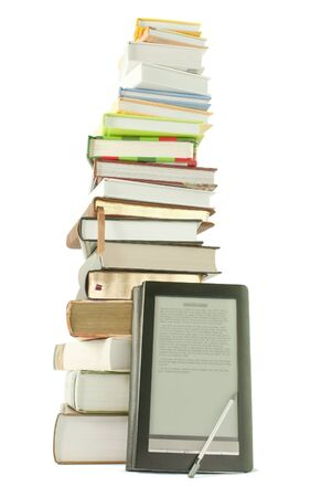 digitized: Tall stack of books and e-book reader on the white background Stock Photo
