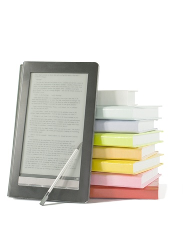 readers: Stack of colorful books and electronic book reader on the white background Stock Photo