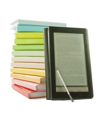 Stack of colorful books and electronic book reader on the white background photo