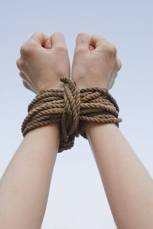 Tied with rope hands photo