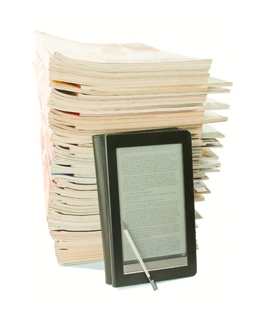Electronic book with a stack of old newspapers behind on white background Stock Photo - 9694497