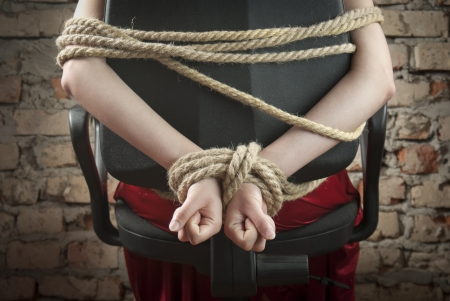 Hands tied up with rope photo