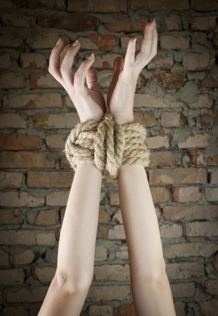 Hands tied up with rope Stock Photo - 9694508