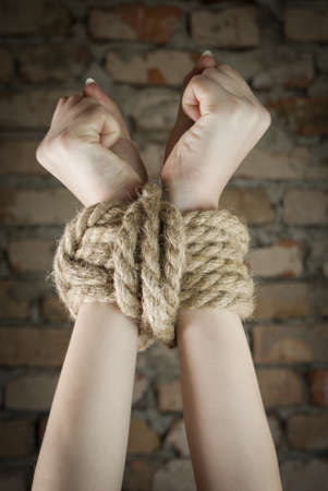 struggling: Hands tied up with rope Stock Photo