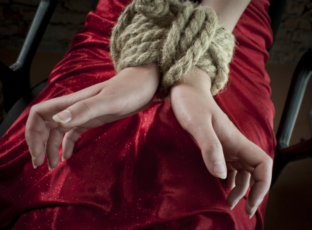 female prisoner: Hands tied up with rope Stock Photo