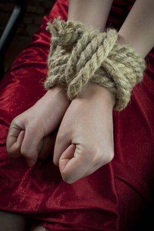 tied knot: Hands tied up with rope Stock Photo