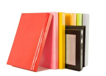 Row of colorful books and electronic book reader on the white background photo
