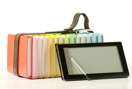 e reading: Stack of colorful books and electronic book reader on the white background Stock Photo