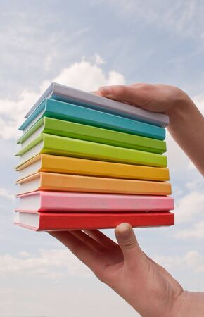hard cover: Hands holding color hard cover books