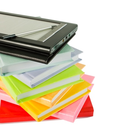 Stack of colorful books and electronic book reader on the white background Banco de Imagens