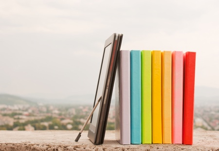 Row of colorful books with electronic book reader Stock Photo - 10127939