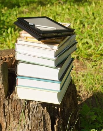 Stack of colorful books and electronic book reader Stock Photo - 10451950