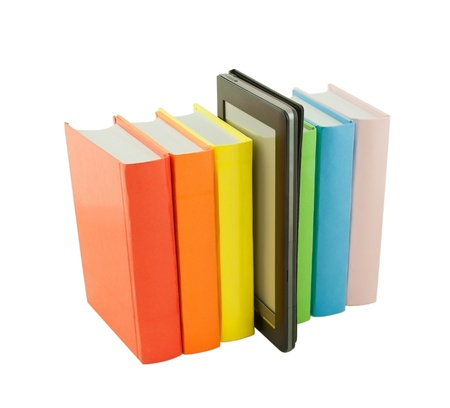 Row of colorful books and electronic book reader isolated on white photo