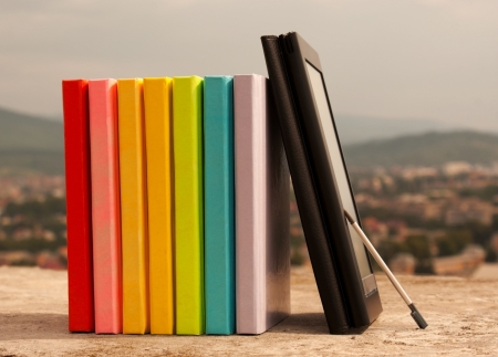 Row of colorful books with electronic book reader Stock Photo - 10879311