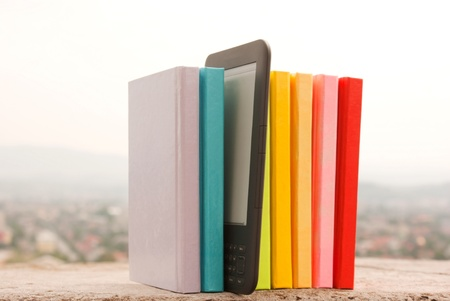 Row of colorful books with electronic book reader Stock Photo - 10915546