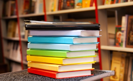 Stack of colorful books with electronic book reader Stock Photo - 10915552