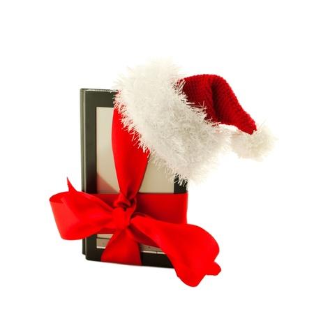 e book reader: Electronic book reader wearing Santa Stock Photo
