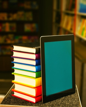 digitized: Stack of books with a tablet PC Stock Photo